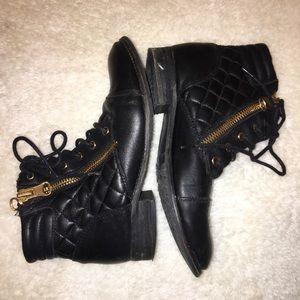 Black zippered boots